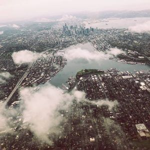 Clouds drift over Seattle, as seen from a bird's eye view.
