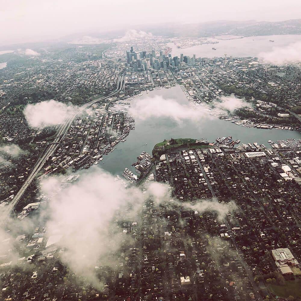 Clouds drift over Seattle, as seen from a bird's eye view.